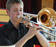 Boy plays trombone solo
