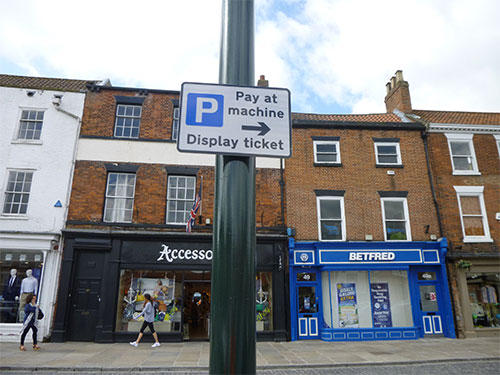 A 'Pay and Display' parking sign
