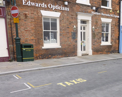 Yellow road markings denote taxi bays
