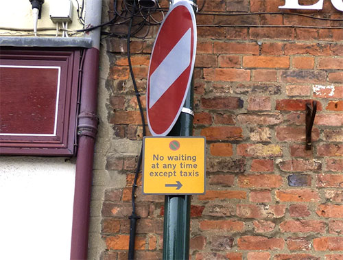 Close up of sign which says 'No waiting at any time except taxis'