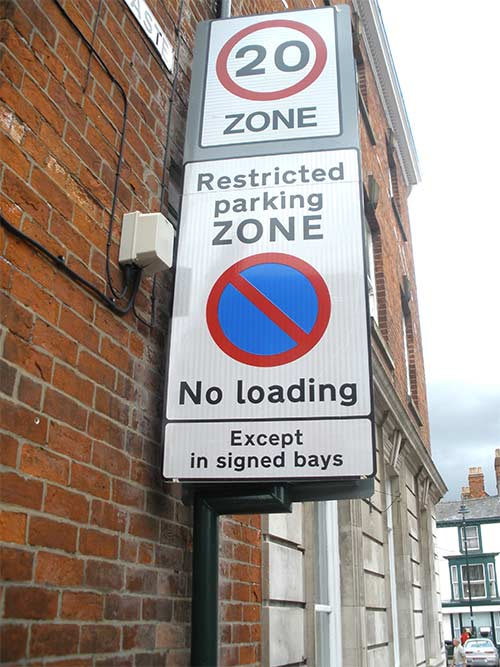 An example of an entry sign, this one states that it's a 'Restricted parking zone. No loading, except in signed bays'.